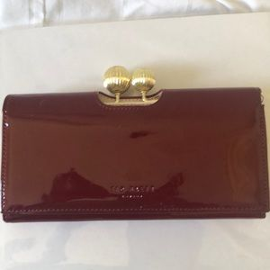 Dark red Ted Baker wallet.